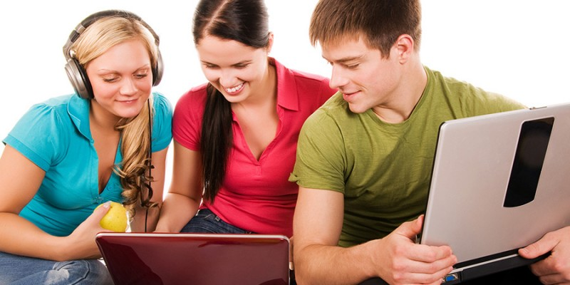 Group of students having fun, doing home work